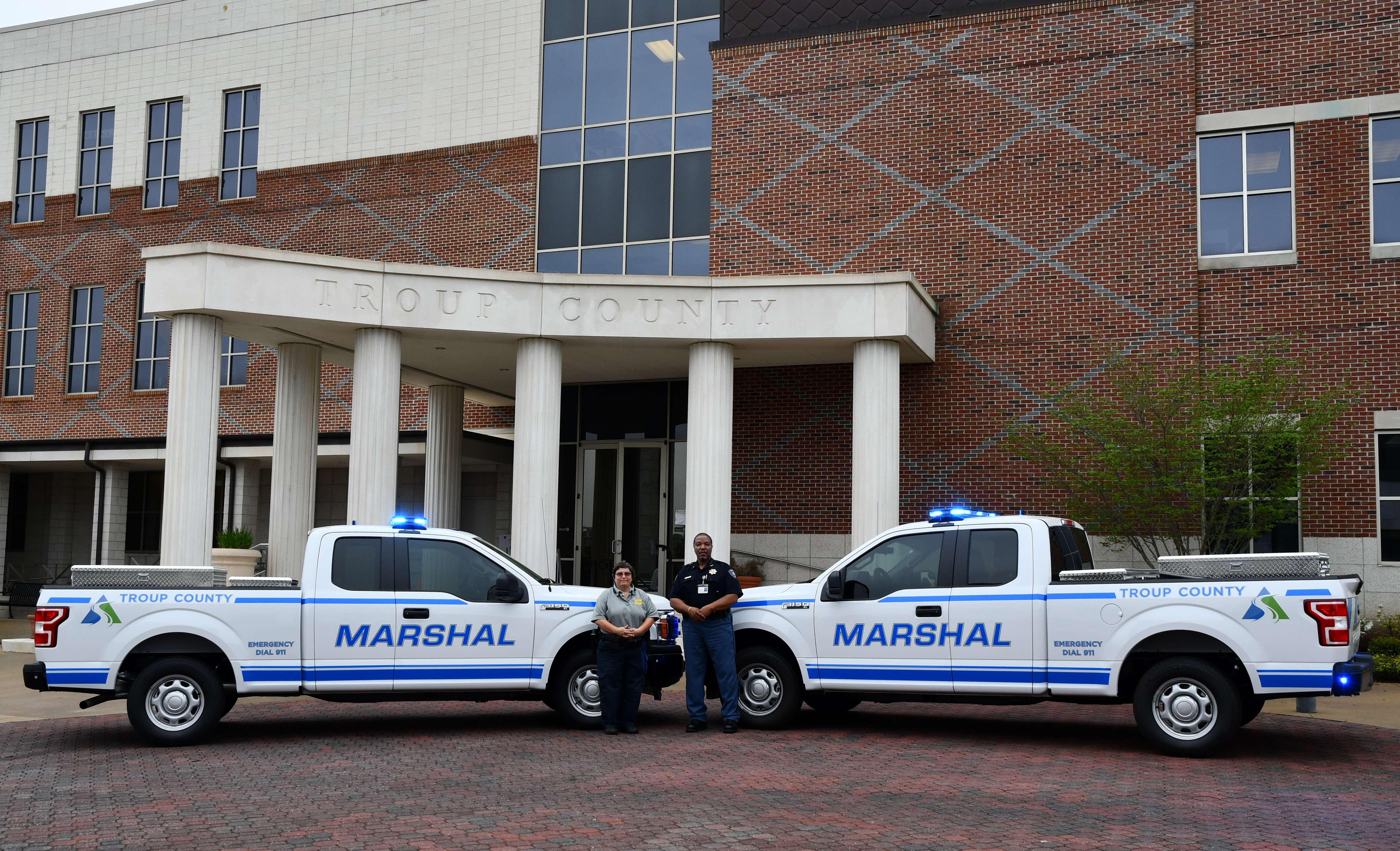 Marshal trucks in front of the Troup County Government center